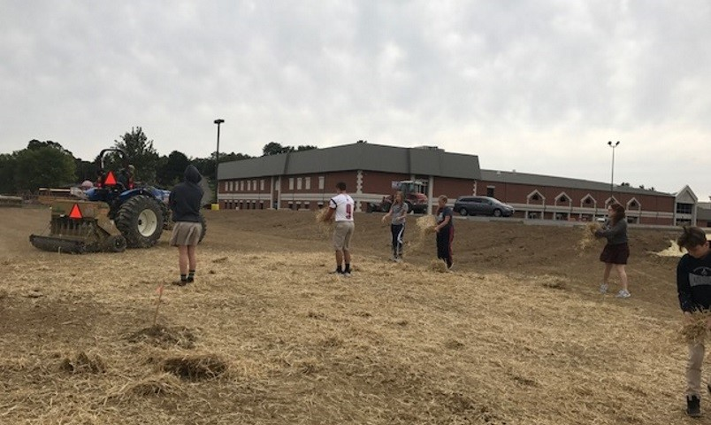 FCA students seeding the infield of the new outdoor athletic fields